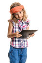 Beautiful girl with multimedia tablet a cute and child red bandana holding a pc in hands isolated on white Stock Images