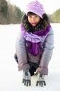 Beautiful girl nature winter snow draws heart Royalty Free Stock Image