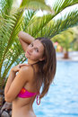 Beautiful girl near the palm trees Royalty Free Stock Photo