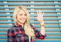 Beautiful girl near the wall on the street in the summer. On a raised hand red paper heart. Colorful hipster photo Royalty Free Stock Photo
