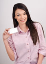 Beautiful girl offering you a visit card young woman smiling holding blank business Stock Photo