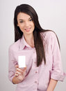 Beautiful girl offering you a visit card young woman smiling holding blank business Royalty Free Stock Photography