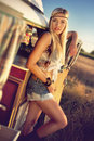 Beautiful girl on an old caravan a blonde hippie beside Stock Images