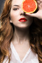 Beautiful girl with orange fruit woman holding Stock Images