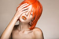 Beautiful girl in an orange wig cosplay style with bright creative lips. Art beauty image.