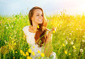 Beautiful girl outdoor enjoy nature meadow allergy free Royalty Free Stock Photo