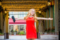 Beautiful girl with outstretched hands in a red dress the city Royalty Free Stock Photo