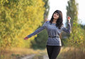 Beautiful girl over autumn background. Royalty Free Stock Photo