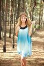 Beautiful girl in pine wood Royalty Free Stock Image