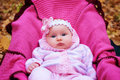 Beautiful girl in a pink baby clothes Royalty Free Stock Photo