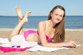 Beautiful girl in pink bikini lying on the beach attractive Royalty Free Stock Image