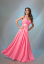 Beautiful girl in pink evening dress Royalty Free Stock Photo