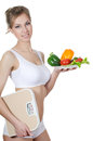 The beautiful girl with a plate with vegetables Royalty Free Stock Photo