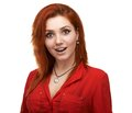 Beautiful girl pleasantly surprised redhead Royalty Free Stock Photo