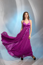 Beautiful girl in plum violet evening dress Royalty Free Stock Image