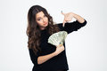 Beautiful girl pointing finger on dollar bills Royalty Free Stock Photo