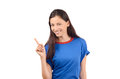 Beautiful girl pointing up attractive with blue t shirt isolated on white Royalty Free Stock Images