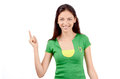 Beautiful girl pointing up attractive with brazilian flag on her green t shirt isolated on white Royalty Free Stock Photography