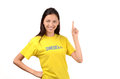 Beautiful girl pointing up attractive with sweden flag on her yellow t shirt isolated on white Stock Photo