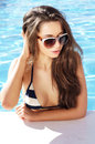 Beautiful girl in pool portrait of young swimming Royalty Free Stock Images