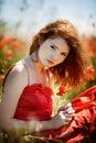 Beautiful girl in poppy field Royalty Free Stock Photo