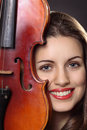 Beautiful girl portrait with a fiddle violin detail model is smiling Royalty Free Stock Photos