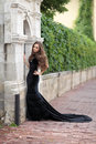 Beautiful girl portrait of a young in a black long dress on the street Royalty Free Stock Images
