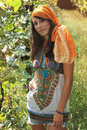 Beautiful girl poses in a grapevine dressed summer and gipsy style Stock Image