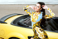 Beautiful girl posing near sport car on the beach Royalty Free Stock Photography