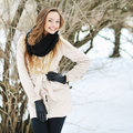 Beautiful girl posing outdoors and smiling in a wintertime near copy space Stock Images