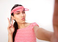 Beautiful girl posing for selfie with peace hand sign Royalty Free Stock Photo