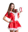 Beautiful girl with present box long brown hair in red crhistmas dress holding on white background Stock Photography