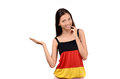 Beautiful girl presenting attractive girl with germany flag blouse isolated on white Royalty Free Stock Images
