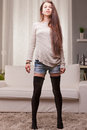 Beautiful girl proudly standing on her pretty long legs watching you as like as she said what do you want Stock Photography