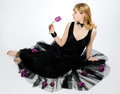 Beautiful girl with purple tulips in black fancy dress Royalty Free Stock Images
