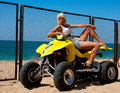 Beautiful girl on a quad sexy blonde the the beach Royalty Free Stock Image