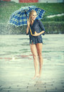 Beautiful girl in rain. Royalty Free Stock Image