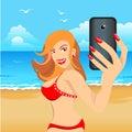 Beautiful girl in red bikini on beach makes selfie Royalty Free Stock Photo