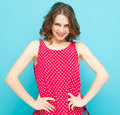 Beautiful girl in a red blouse with polka dots on blue background Royalty Free Stock Photo