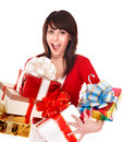 Beautiful girl in red with group  gift box. Royalty Free Stock Photo