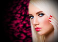 Beautiful girl with red lips and nails blonde Stock Image
