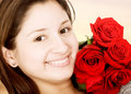 Beautiful girl with red roses Royalty Free Stock Photography