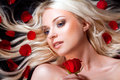 Beautiful girl red roses her blond hair roses Royalty Free Stock Images
