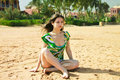 Beautiful girl is relaxing on the sand on the beach Royalty Free Stock Photos