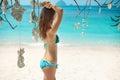 Beautiful girl relaxing on the tropical beach in bikini paradise summer vacation Stock Photos