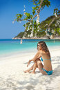 Beautiful girl relaxing on the tropical beach in bikini paradise summer vacation Royalty Free Stock Images