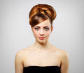 Beautiful girl with retro hairstyle on gray Stock Photos