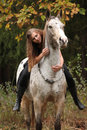 Beautiful girl riding a horse without bridle or saddle Royalty Free Stock Photo