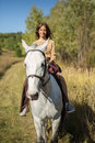 Beautiful girl riding a white horse Royalty Free Stock Photo