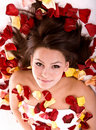 Beautiful girl in rose petal. Royalty Free Stock Photo
